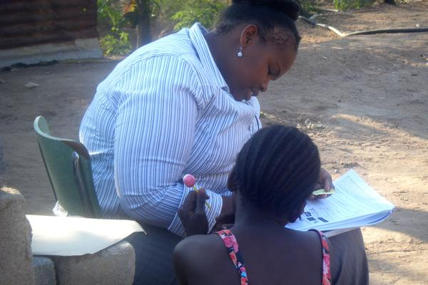 A young girl being interviewed by a woman in South Africa