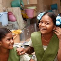 Photo of two young girls for Young Lives case study